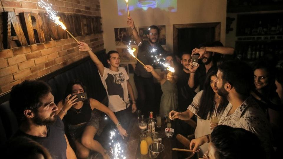 People celebrate a friend's birthday in Marionette bar in the Old City of Damascus. Even during the fighting, people in Damascus would go out in the evenings to eat, drink and dance, but this summer, the bars and restaurants of the Old City were much busier. (Marko Djurica / REUTERS)