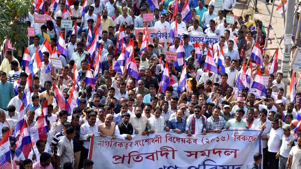 Members of Asom Gana Parishad (AGP) take out a protest rally against the Centre's bid to pass the Citizenship (Amendment) Bill, 2016, in Guwahati. On Tuesday morning, protesters burnt tyres, disrupted vehicular and rail traffic at several places in the state during a 12-hour shutdown called by 46 indigenous groups in Assam against the proposed Citizenship (Amendment) Bill. (Rajib Jyoti Sarma / HT Photo)