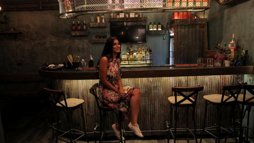 """I like my job. I like bars and night life here. But in the end I would like to move out of Syria. I don't see a future here,"" said Rasha, a 30-year-old bar owner. ""When there was war here and we had bombs falling every day I never wanted to leave. But now, yes,"" she said. (Marko Djurica / REUTERS)"