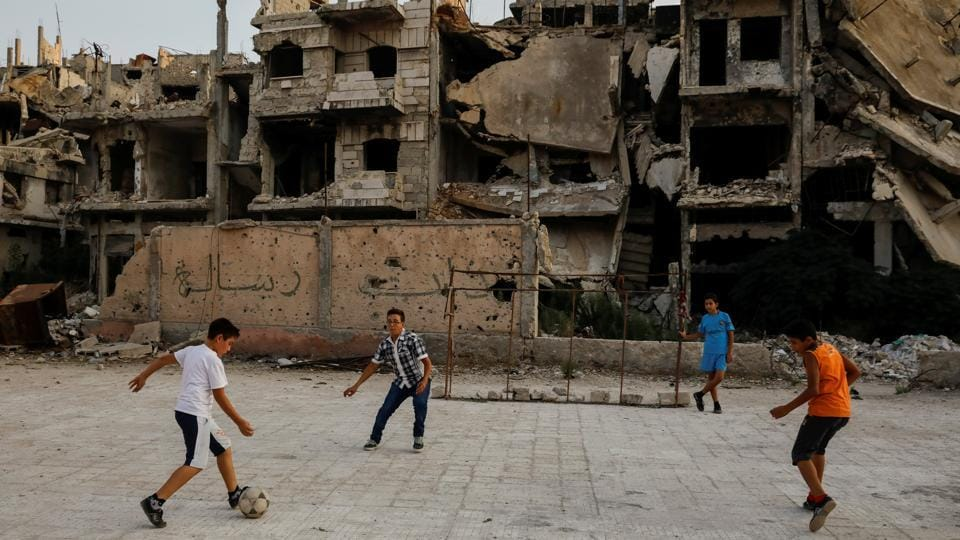 Children play soccer in al-Khalidiya area, in the government-controlled part of Homs. In the city's al-Khalidiya district, retaken by the government in 2013, the slow nature of recovery is clear and much of it is a ghost town, uninhabited and closed off by the army. (Marko Djurica / REUTERS)