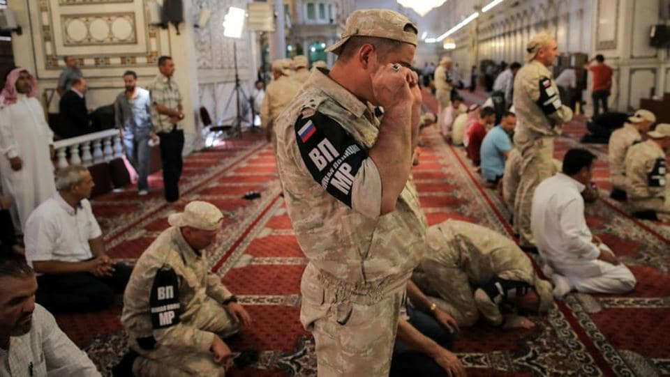 Russian soldiers pray inside the Umayyad mosque. Syria cannot afford a major rebuilding programme. Its closest allies, Russia and Iran, seem unlikely to foot the bill. Western nations will pay no cash without a political transition. (Marko Djurica / REUTERS)