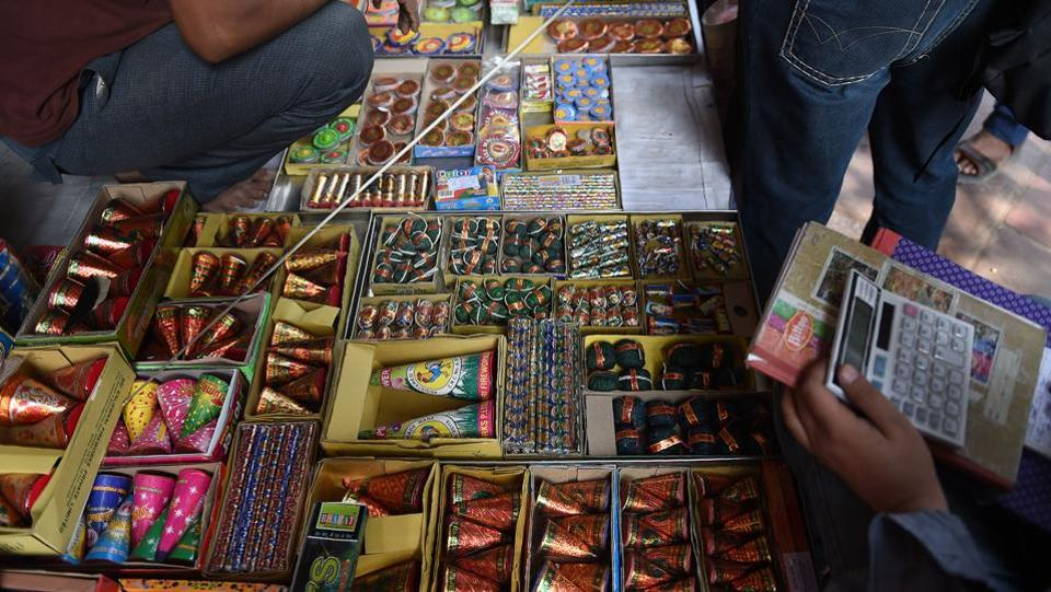 The Supreme Court on Tuesday said that people can burst low-emission firecrackers between 8pm and 10pm this Diwali, ruling against a blanket ban on fireworks. It also stipulated a 35-minute window for new year celebrations setting a time between 11:55pm to 12:30am for bursting crackers. No fire crackers would be burst during the day, it said. (Money Sharma / AFP)