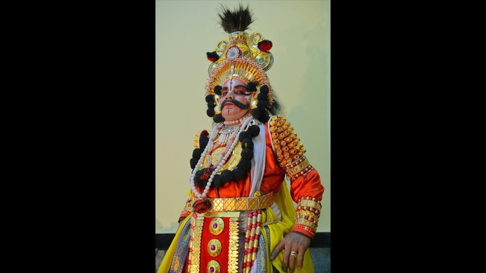 An actor in a king's costume (raja vesha). Traditionally costume pieces have been made out of light wood wrapped in coloured foil, used mirrors and coloured stones while newer materials may be used now. Of note are the Yakshagana headgear, chestplates and armbands. Costumes use tones of red, orange and yellow in abundance. (Manjunath Kiran / AFP)