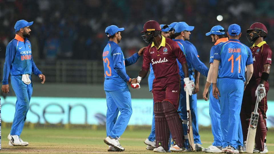 Indian cricket captain Virat Kohli (L) and teammates greet West Indies batsmen after a tied at the end of the second one day international (ODI) cricket match between India and West Indies tied at the Dr. Y.S. Rajasekhara Reddy ACA-VDCA Cricket Stadium in Visakhapatnam (AFP)