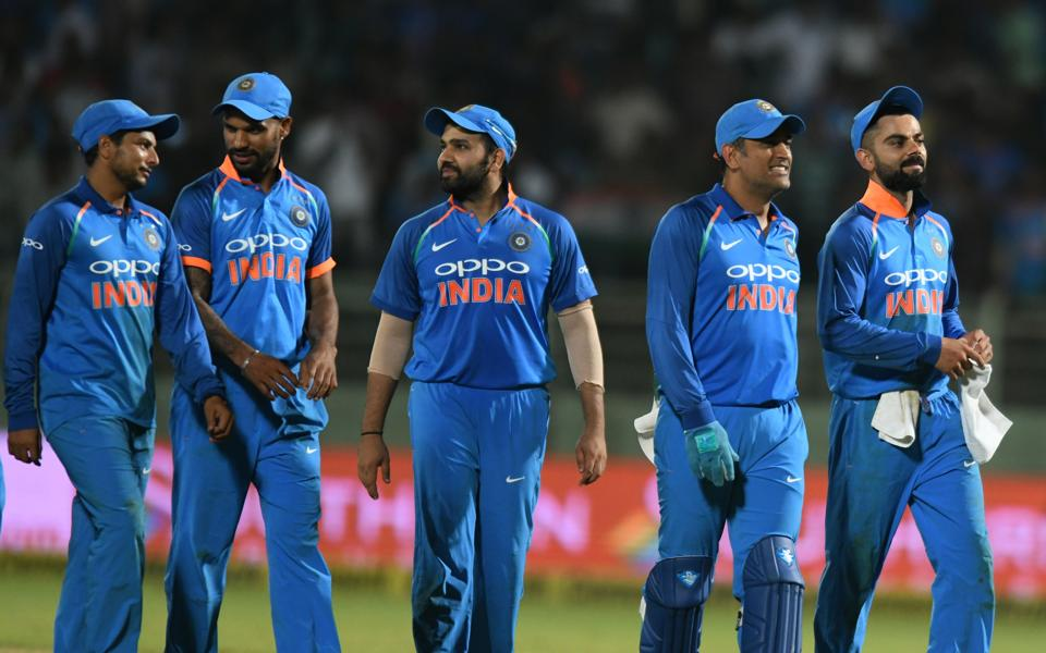 Indian cricket captain Virat Kohli (R) leaves the field with teammates after they tied against West Indies during the second one day international (ODI) cricket match between India and West Indies at the Dr. Y.S. Rajasekhara Reddy ACA-VDCA Cricket Stadium in Visakhapatnam. (AFP)