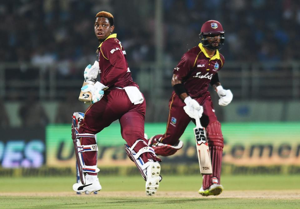 West Indies cricketers Shai Hope (R) and Shimron Hetmyer run between the wickets during the second one day international (ODI) cricket match between India and West Indies at the Dr. Y.S. Rajasekhara Reddy ACA-VDCA Cricket Stadium in Visakhapatnam. (AFP)