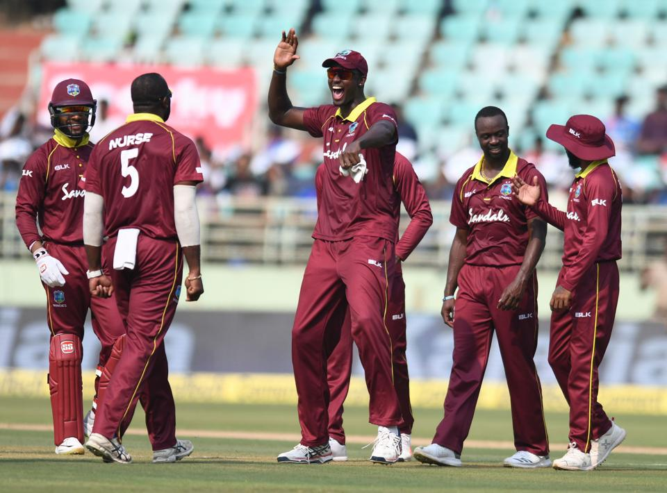 West Indies cricket captain Jason Holder (C) celebrates with his teammates for the dismissal of Indian cricketer Shikhar Dhawan during the second one day international (ODI) cricket match between India and West Indies at the Dr. Y.S. Rajasekhara Reddy ACA-VDCA Cricket Stadium in Visakhapatnam. (AFP)