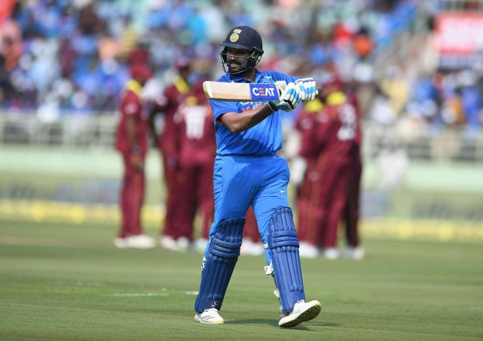 Indian cricketer Rohit Sharma walks back to the pavillion during the second one day international (ODI) cricket match between India and West Indies at the Dr. Y.S. Rajasekhara Reddy ACA-VDCA Cricket Stadium in Visakhapatnam. (AFP)