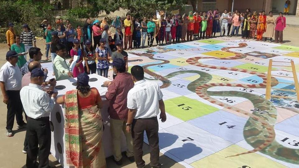District authorities have created a 1600 square feet sized 'Snake and ladder' board to generate electoral awareness in barmer on Tuesday. (HT Photo)