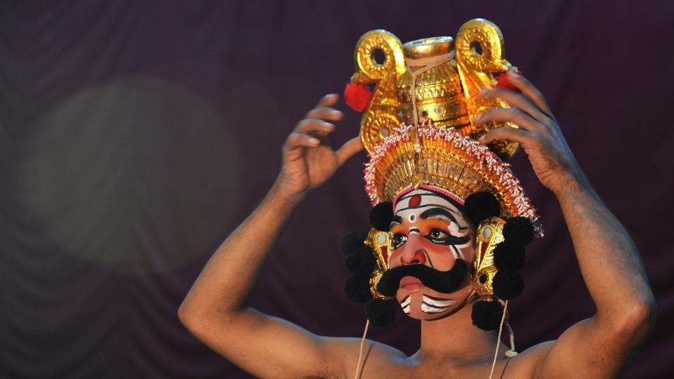 "A ""Yakshagana"" artist prepares prior to a performance in a theatre in Bangalore. A literal compound of yaksha (nature spirit) and gana (song or praise), Yakshagana is a form of theatre indigenous to Karnataka and also performed in Kerala's Kasargod district. It has a recorded history of at least five centuries as a distinct art form. (Manjunath Kiran / AFP)"