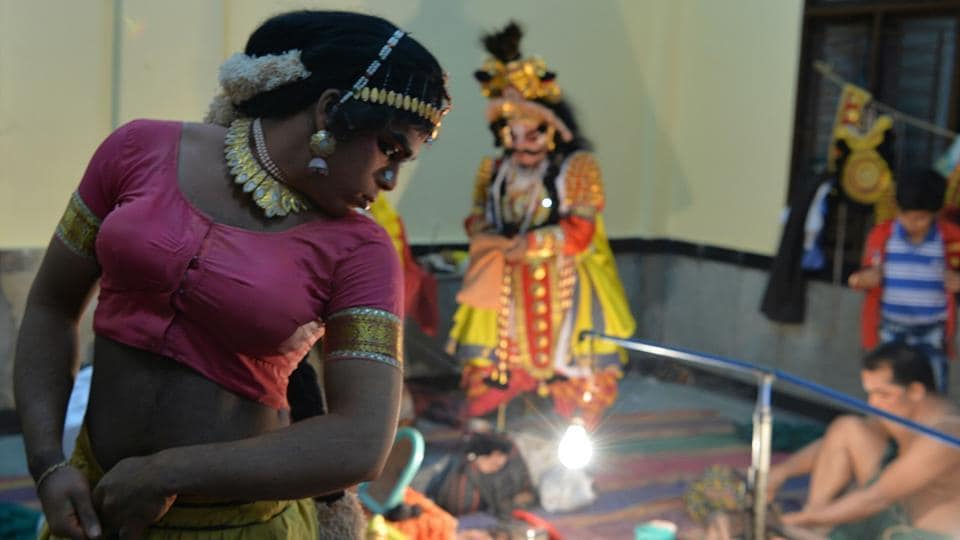 Performances following in tradition still have male actors portraying female roles, as troupes in centuries past were attached to temple complexes. The entry of women into Yakshagana troupes, newer themes and interpretations as well as commercial performances are all developments of the 20th century. (Manjunath Kiran / AFP)