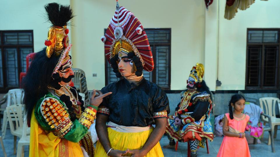 Artists backstage before a performance. Training is often years long and in the form of an apprenticeship. The method of instruction is observational, and the student takes on roles, growing from a minor stage presence to male or female leads depending on aptitude and oratory prowess. Actors branch out into specialist roles depending on improvisation skills and physical attributes. (Manjunath Kiran / AFP)