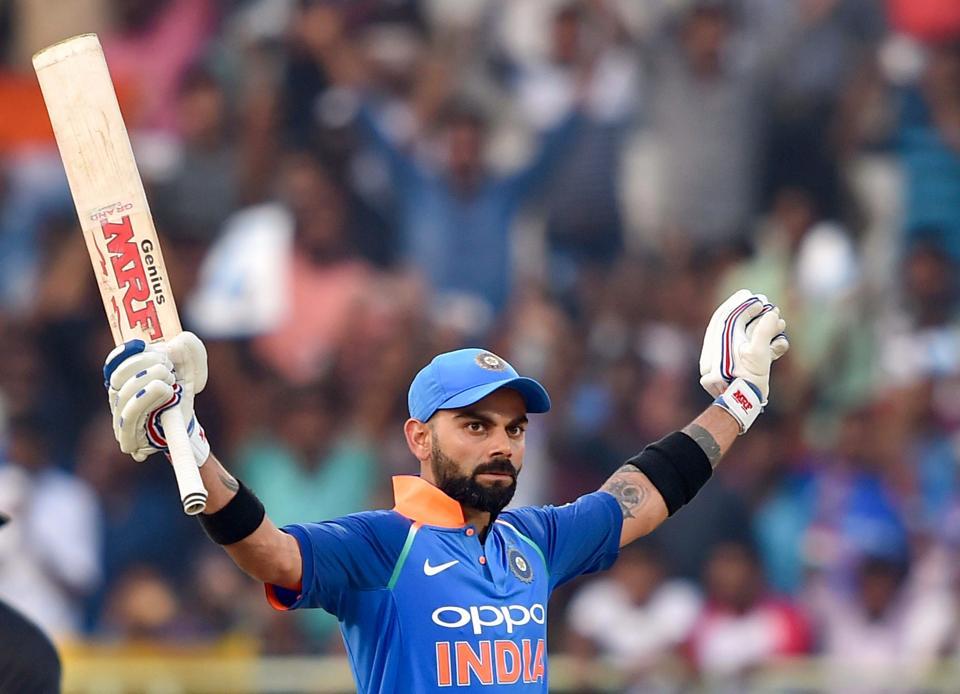 Visakhapatnam: Indian batsman Virat Kohli celebrates his century during the 2nd ODI cricket match against West Indies in Visakhapatnam. (PTI)