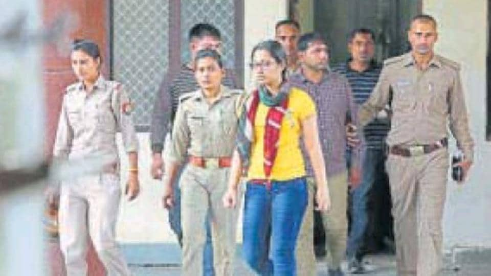 Sonia Dhawan and the other accused in the case of alleged extortion from the Paytm founder being led away at a court on Tuesday.