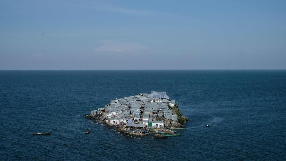 A rounded rocky outcrop covered with metallic shacks, Migingo Island rises out of the waters of Lake Victoria like an iron-plated turtle. The densely populated island is barely a quarter of a hectare large, its residents crammed into a hodge-podge of corrugated-iron homes. There's little else but a few bars, brothels and a tiny port. (Yasuyoshi Chiba / AFP)
