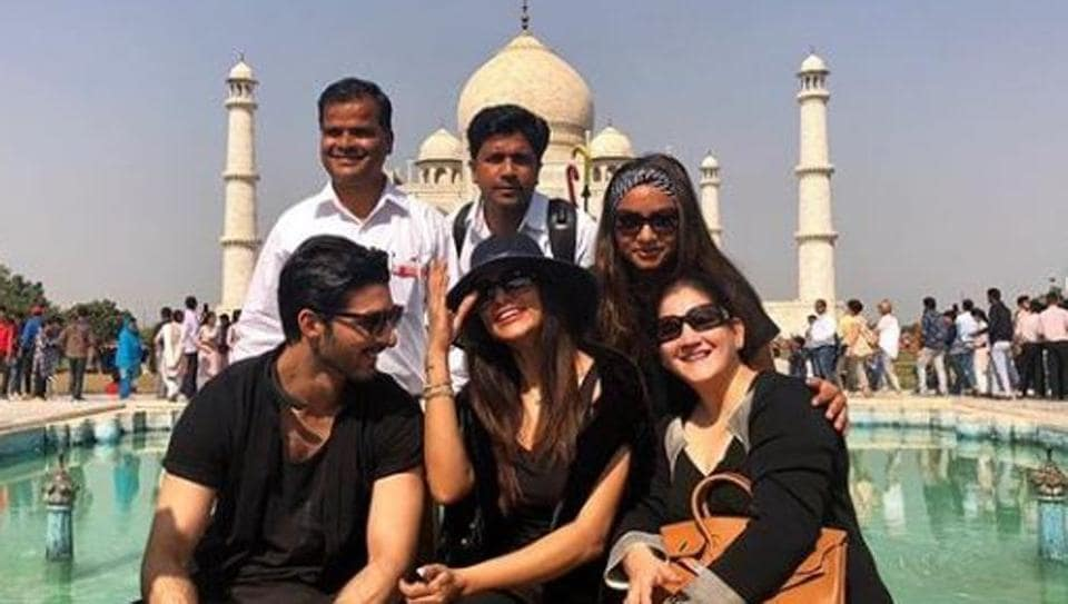 Sushmita Sen poses in front of the Taj Mahal with her team and rumoured boyfriend Rohman Shawl.