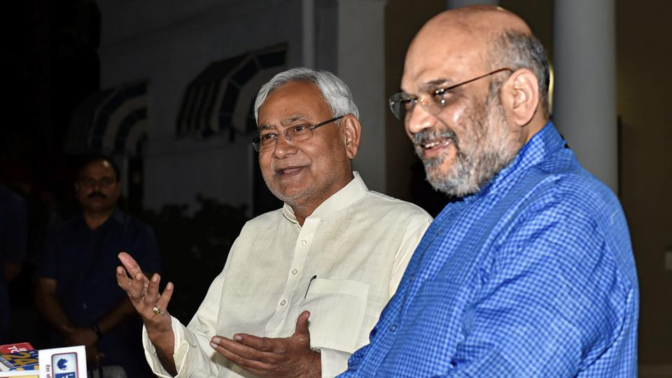 BJP President Amit Shah and Bihar Chief Minister Nitish Kumar interact with the media at the former's residence in New Delhi, Friday, Oct 26, 2018.