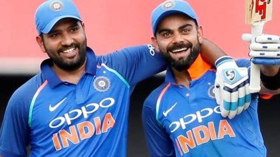 Virat Kohli (R) celebrates his century with teammate Rohit Sharma.