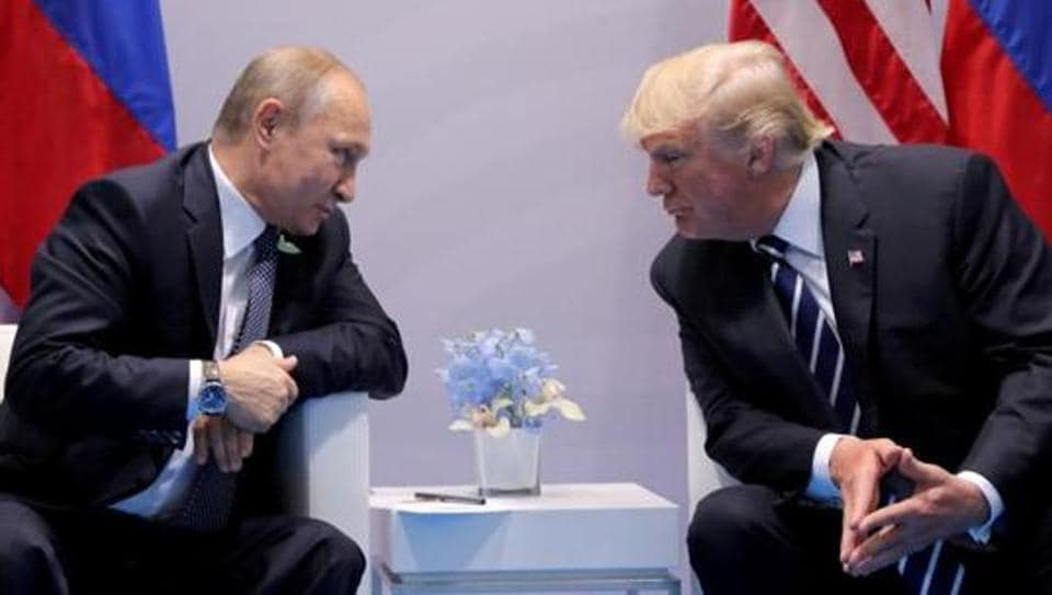 Russia's President Vladimir Putin talks to U.S. President Donald Trump during their bilateral meeting at the G20 summit in Hamburg, Germany, July 7, 2017. REUTERS/Carlos Barria/Files