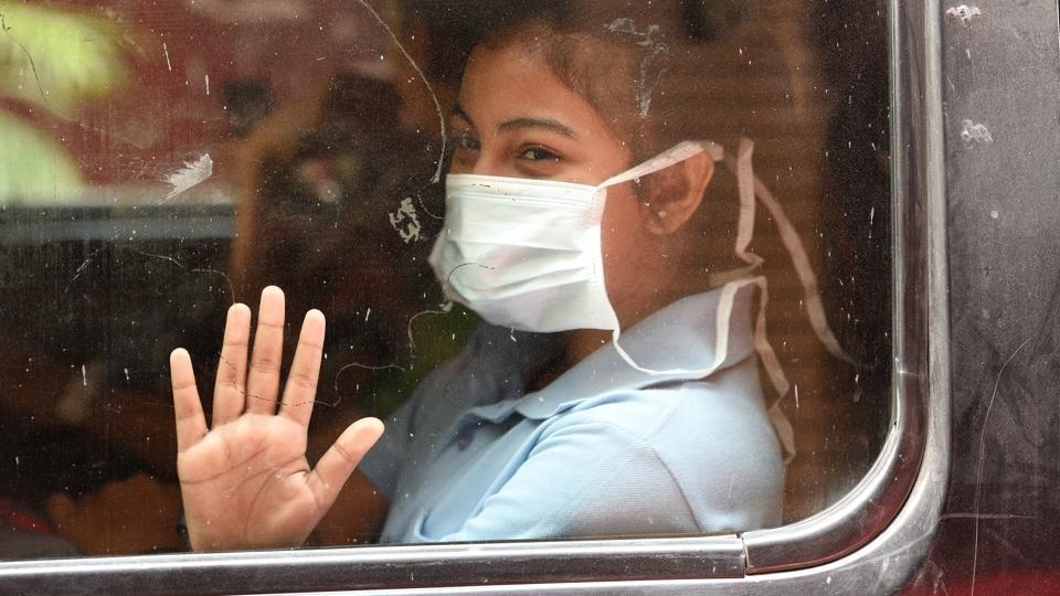 A girl covers her face with a mask to protect from the city's rising pollution levels in New Delhi (Raj K Raj / HT Photo)
