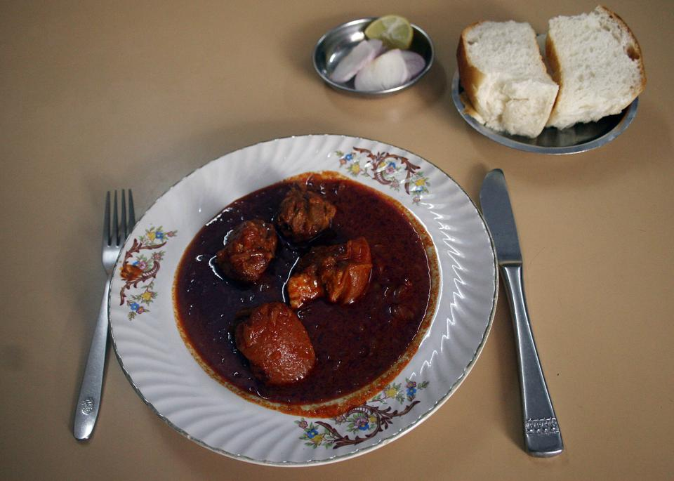 Pork Vindaloo at New Martin, Colaba, served with a side of soft pav. Vinegar gives the dish a racy acidity that complements beautifully the rich fattiness of the meat.