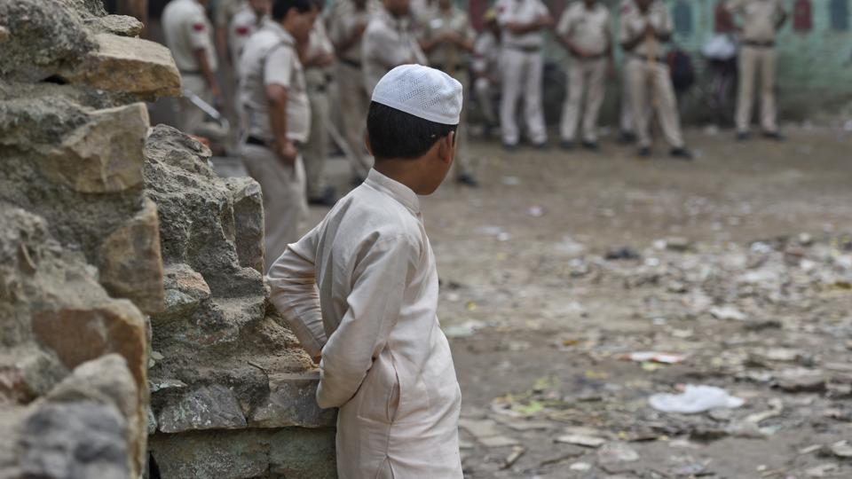 A boy looks at the police deployment in south Delhi's Malviya Nagar on Thursday.