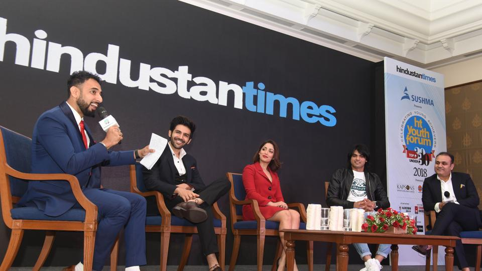 (Left to Right) RJ Rahul Makin with panellists actor Kartik Aaryan, actress Yami Gautam, athlete Neeraj Chopra and cricketer Virender Sehwag during the 7th edition of HT Youth Forum 30-under-30 2018 event held in Chandigarh on Friday. The panellists discussed if India's demographic dividend has really delivered.  (Sanjeev Sharma/HT)
