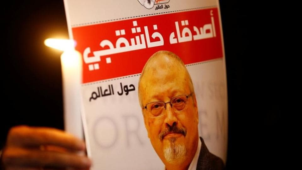 A demonstrator holds a poster with a picture of Saudi journalist Jamal Khashoggi outside the Saudi Arabia consulate in Istanbul, Turkey.