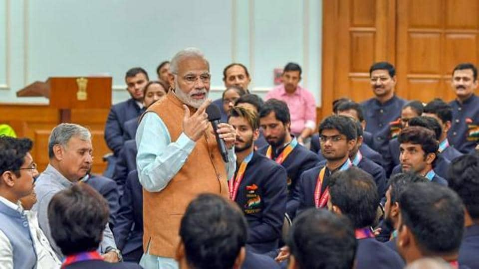 Narendra Modi interacting with the medal winners of the 2018 Asian Para Games, in New Delhi on October 16, 2018.