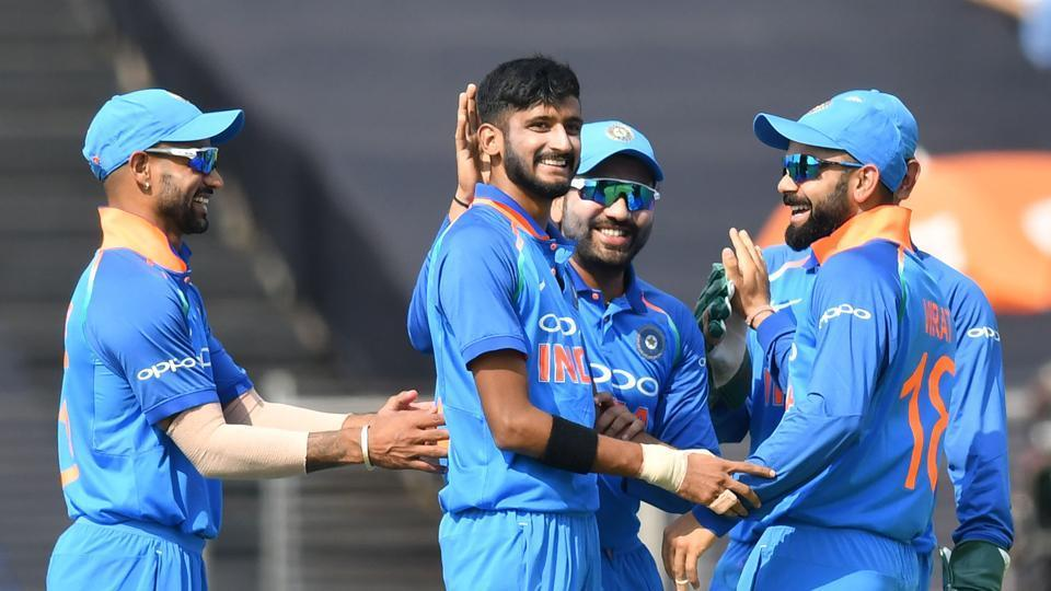 India bowler Khaleel Ahmed (C) celebrates with captain Virat Kohli (R), Rohit Sharma and Shikhar Dhawan (L) after taking the wicket of West Indies cricketer Marlon Samuels during the third one day international (ODI) cricket match between India and West Indies at the Maharashtra Cricket Association Stadium in Pune.