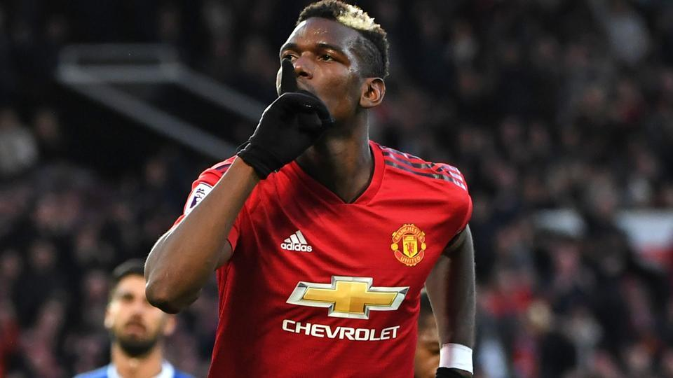 Manchester United midfielder Paul Pogba celebrates after scoring the opening goal.