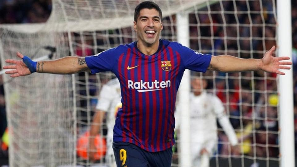 Barcelona's Luis Suarez celebrates scoring their fourth goal and completing his hat-trick.