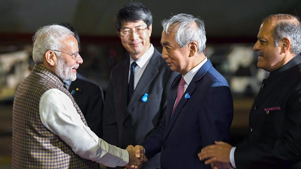 Prime Minister Narendra Modi being welcomed by the dignitaries, on his arrival at Haneda International Airport, to attend the India-Japan Annual Summit, in Tokyo, Japan, on October 27, 2018.