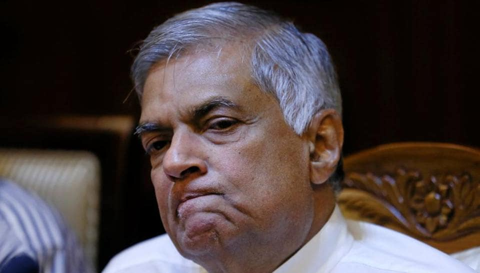 Sri Lanka's sacked Prime Minister Ranil Wickremesinghe reacts during a news conference with Sri Lanka's Foreign Media Association in Colombo, Sri Lanka.