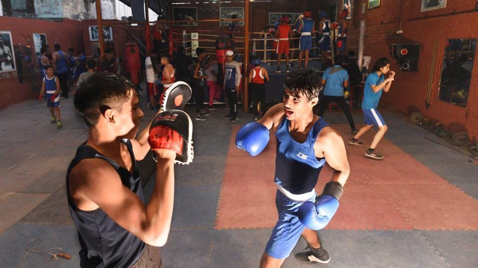 In Najafgarh, known for having produced cricketing great Virender Sehwag and Olympic silver medal winning wrestler Sushil Kumar, a silent boxing revolution is taking place. Every day, hundreds of children and teenagers --both girls and boys—can be spotted practising punches inside the many boxing academies that have sprung up in Najafgarh and its surrounding villages. (Vipin Kumar / HT Photo)
