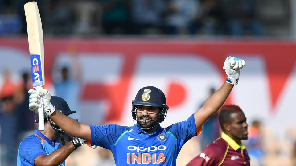 Rohit Sharma (C) celebrates after scoring his century (100 runs) against West Indies. (AFP)