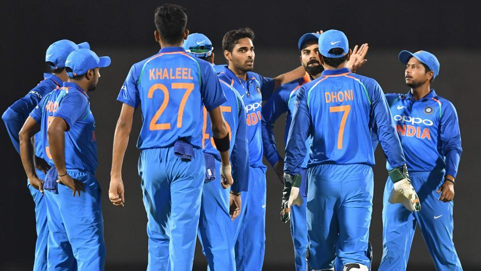India players celebrate after the wicket of West Indies batsman Chandrapaul Hemraj. (AFP)