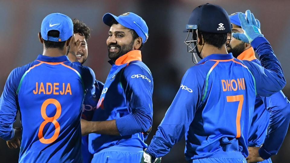 India cricketer Rohit Sharma (C) celebrates with teammates after taking the catch to dismiss West Indies batsman Ashley Nurse during the fourth one day international (ODI) cricket match between India and West Indies at the Brabourne Stadium.