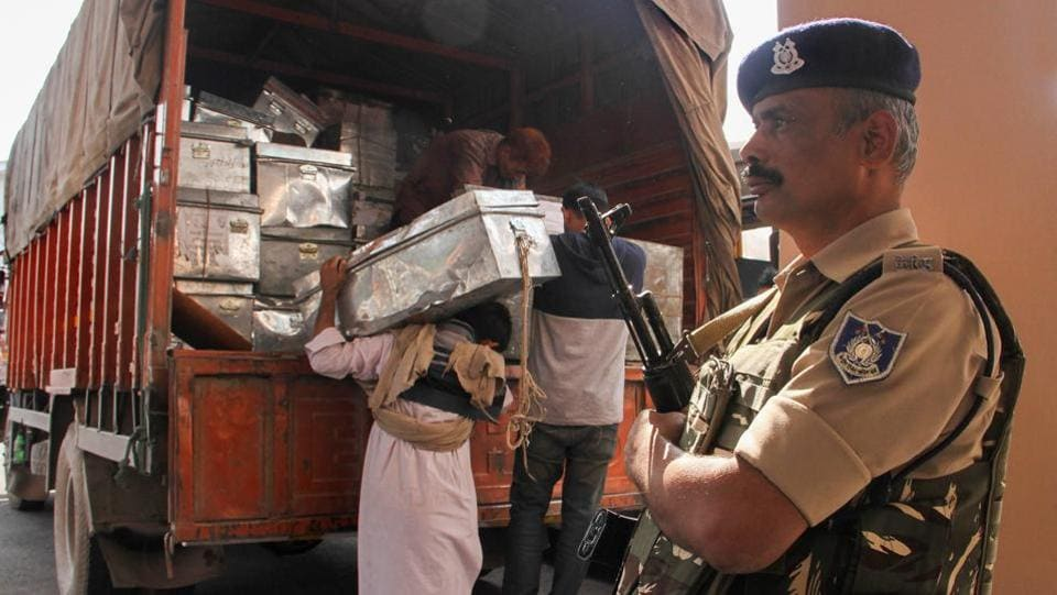 Workers unload official documents from a truck during the annual 'Darbar Move' at Civil Secretariat, in Jammu. (PTI)