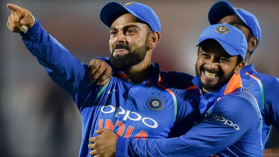 Virat Kohli celebrates with his teammates the dismissal of West Indies' batsman Kieran Powell.