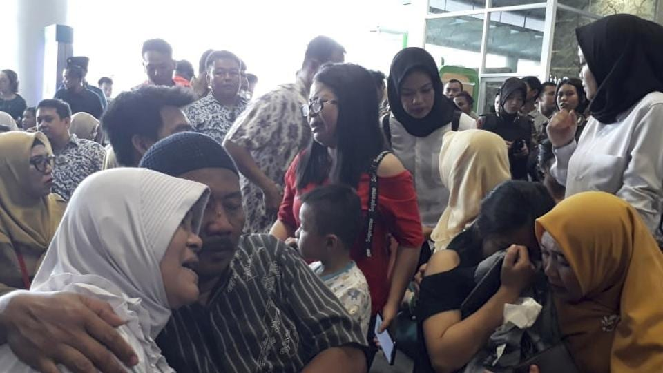 Relatives of passengers comfort each other as they wait for news on a Lion Air plane that crashed off Java Island at Depati Amir Airport in Pangkal Pinang, Indonesia Monday, Oct. 29, 2018. Indonesia disaster agency says that the Lion Air Boeing 737-800 plane crashed into sea shortly after it left Indonesia's capital Monday morning. (AP Photo)