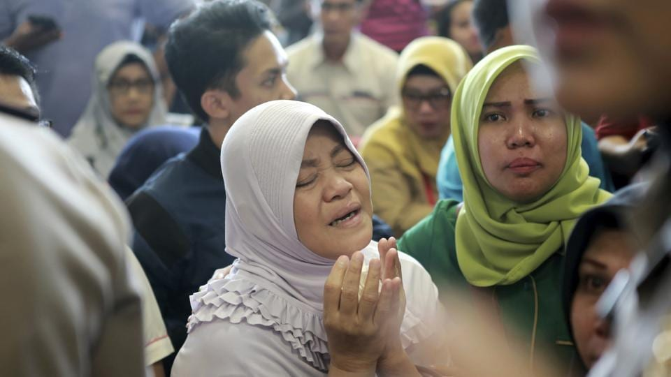 A relative of passengers prays as she and others wait for news at Depati Amir Airport. Spokesman Sutopo Purwo Nugroho said the aircraft, on a 1 hour and 10 minute flight to Pangkal Pinang on an island chain off Sumatra, was carrying 181 passengers, including one child and two babies, and eight crew members. (Hadi Sutrisno / AP)