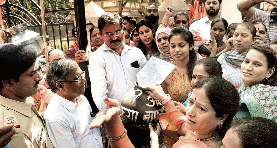 Residents of Shivajinagar and members of the Shiv Sena protest water cuts at PMC's Ghole Road ward office on Monday