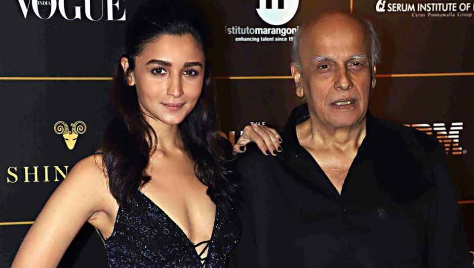 Bollywood actor Alia Bhatt poses for photos with producer Mahesh Bhatt during Vogue Women Of The Year Awards red carpet event, in Mumbai.