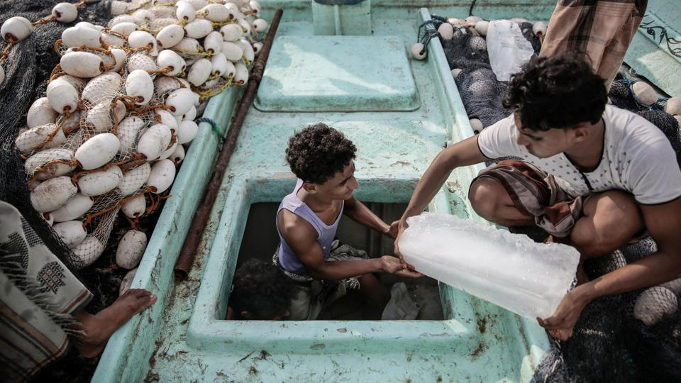 The fishermen try to avoid the coalition warships, which are on the lookout for weapons smugglers and rebels armed with rockets and explosives. The Houthis have carried out several attacks on ships off Yemen's coast. (Hani Mohammed / AP)