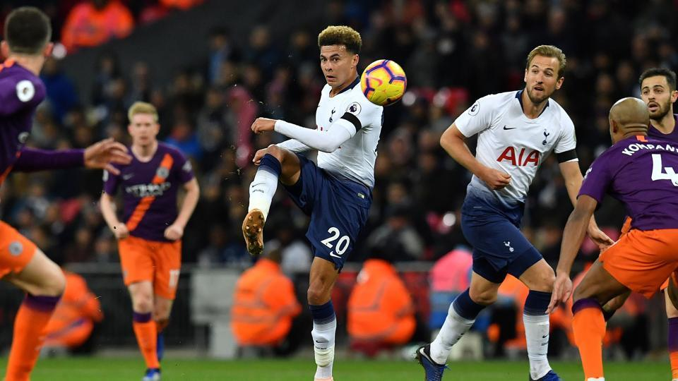 Tottenham Hotspur's English midfielder Dele Alli (C) crosses the ball during the English Premier League football match between Tottenham Hotspur and Manchester City at Wembley Stadium in London.