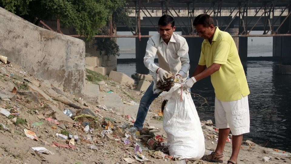 Volunteers clean up the Chhath Ghat at Yamuna River as part of the Clean Yamuna drive.