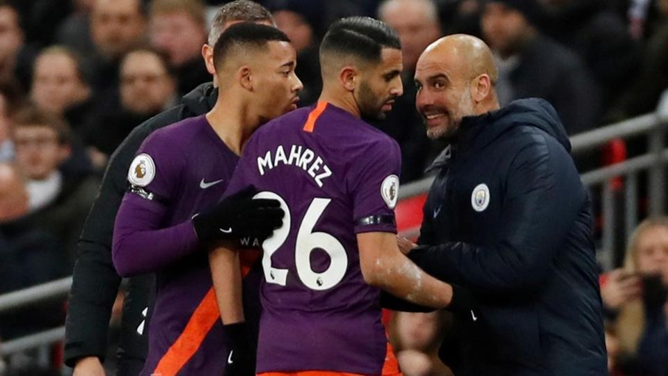 Manchester City players celebrate with manager Pep Guardiola on Monday.