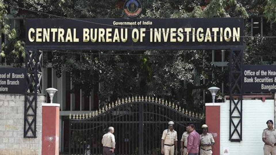 Security personnel stand guard outside the CBI headquarters in Bengaluru.
