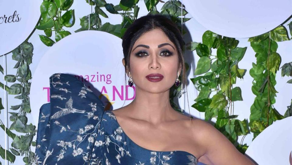 Shilpa Shetty stuns in a pale blue and white off-shoulder gown.